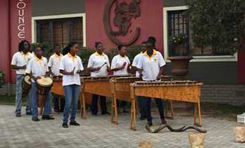 Namib Marimbas performing in front of the Cosmopolitan Lounge in Swakopmund