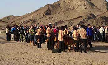 Namib Marimbas performing at an event in the desert
